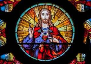 Sacred Heart at the centre of a rose window,
